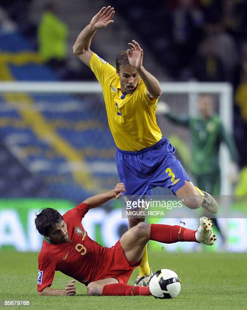 Sweden's Olof Mellberg vies with Portugal´s Danny Gomes during their WC2010 Group 1 qualifier football match at the Dragao Stadium in Porto on March...