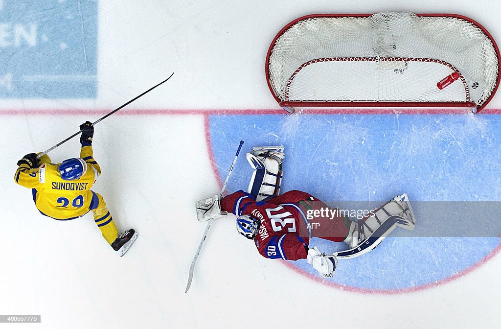 Sweden's Oskar Sundqvist (R) scores 2-0 against Russia's goalkeeper Andrei Vasilevski during the World Junior Hockey Championships semifinal between Sweden and Russia at Malmo Arena in Malmo, Sweden on January 4, 2014. Sweden won 2-1 and plays in the final on January, 5.