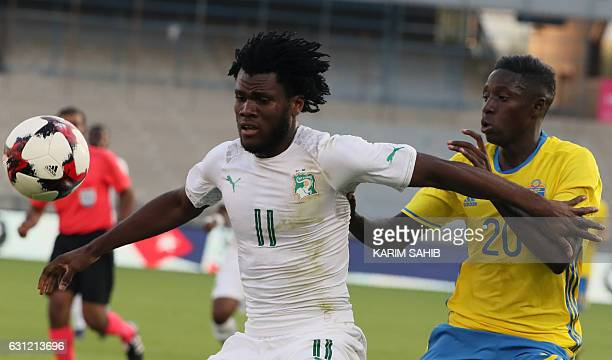 Sweden's Pa Konate vies for the ball against Ivory Coast's Franck Kessie during the International friendly football match between Sweden and Ivory...