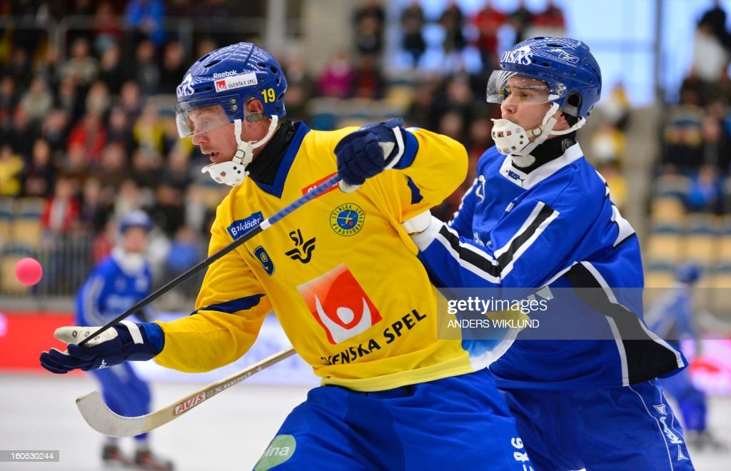 Sweden's Patrik Nilsson and Finland's Samuli Helavuori vie during Bandy World Championship semifinal match Sweden vs Finland in Vanersborg, Sweden, February 2, 2013.