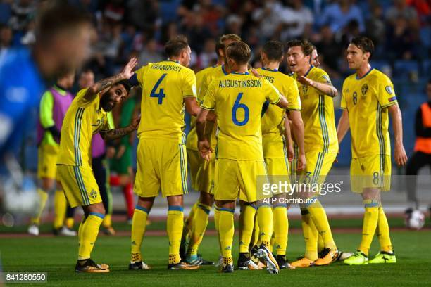 Sweden's players celebrate after a goal during the FIFA 2018 World Cup football qualifier match between Bulgaria and Sweden in Sofia on August 31...