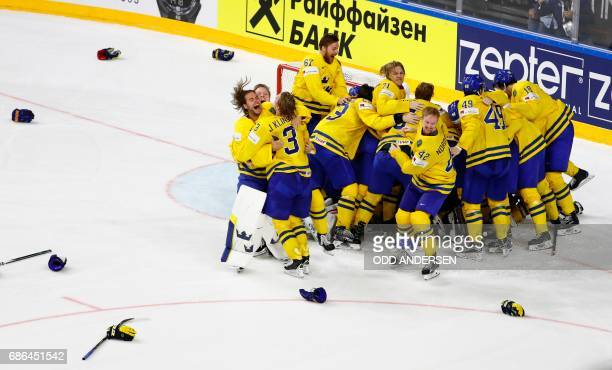 TOPSHOT Sweden's players celebrate after the penalty shootout of the IIHF Men's World Championship Ice Hockey final match between Canada and Sweden...