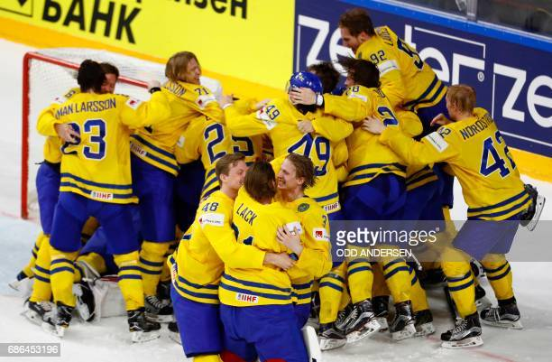 Sweden's players celebrate after the penalty shootout of the IIHF Men's World Championship Ice Hockey final match between Canada and Sweden in...