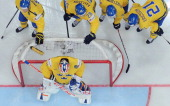 Sweden's players gather around their net before a IIHF International Ice Hockey World Championship quarterfinal game between Sweden and Belarus in...