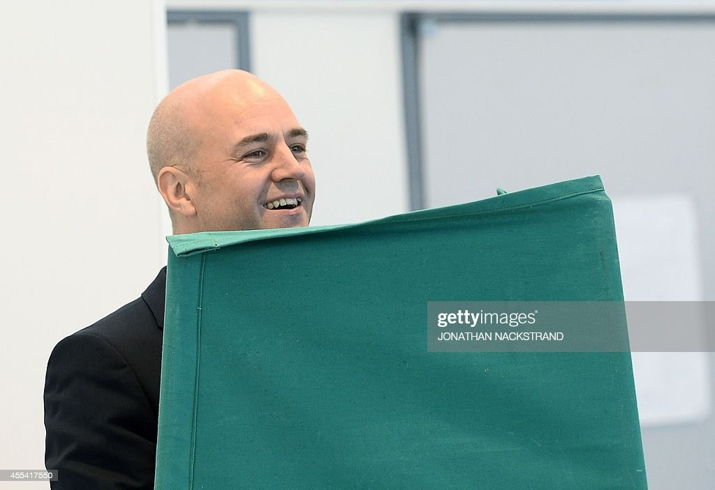 Sweden's Prime Minister and leader of the Moderate Party, Fredrik Reinfeldt smiles as he votes at a polling station during the Swedish general elections in the Stockholm suburb of Taeby on September 14, 2014. Polling booths opened at 0600 GMT and will close 12 hours later, determining the allocation of 349 seats in the Nordic country's legislature, the Riksdag. AFP PHOTO/JONATHAN NACKSTRAND