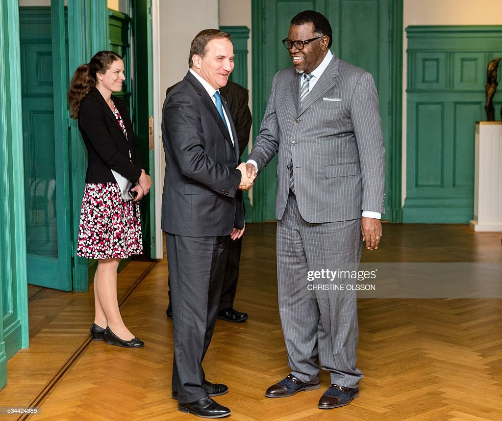 Sweden's Prime Minister Stefan Lofven (L) greets President Hage Geingob of Namibia as he arrives on May 26, 2016 in Stockholm to the government building Rosenbad for bi-lateral talks. News Agency / Christine Olsson / Sweden OUT