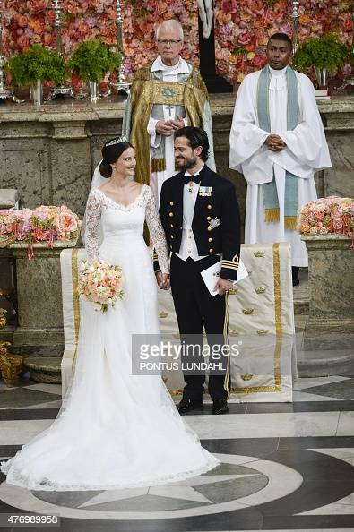 Sweden's Prince Carl Philip and Sofia Hellqvist's stand at the alter during their wedding ceremony at the Royal Chapel in Stockholm Palace on June 13...