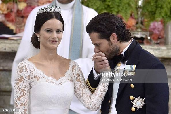 Sweden's Prince Carl Philip kisses Sofia Hellqvist's hand during their wedding ceremony at the Royal Chapel in Stockholm Palace on June 13 2015 AFP...