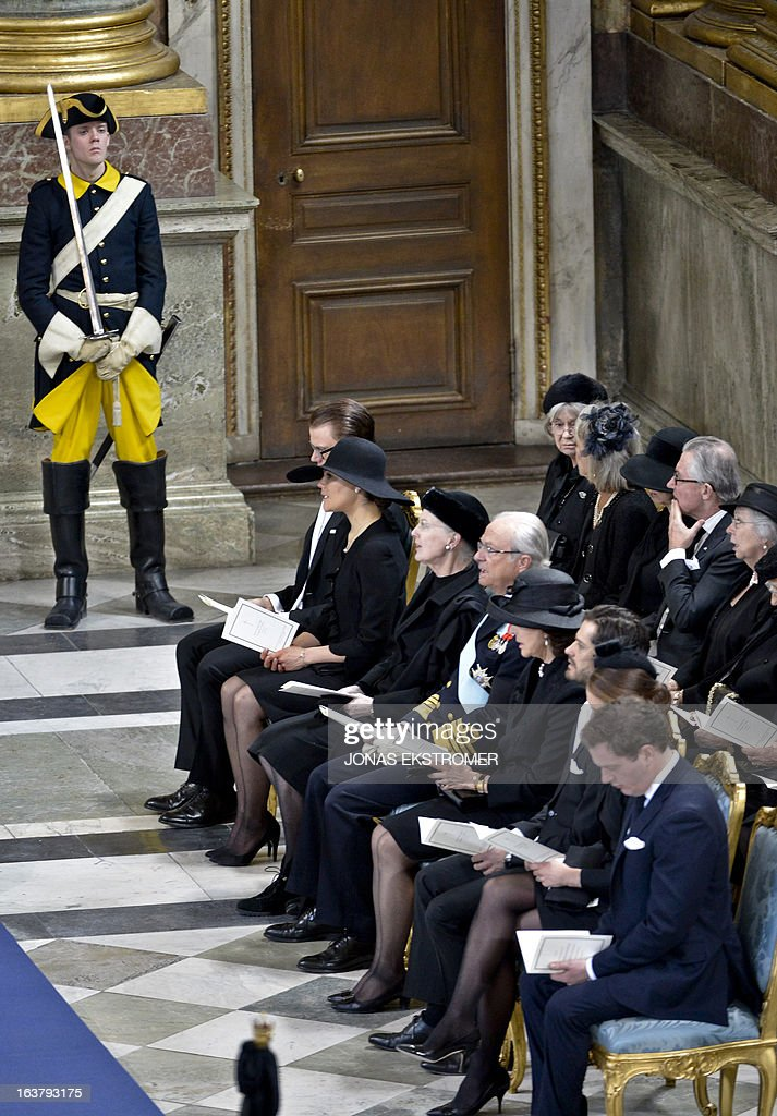 Sweden's Prince Daniel, Crown Princess Victoria, Denmark's Queen Margrethe, Sweden's King Carl Gustaf, Queen Silvia, Sweden's Prince Carl Philip, Swedish Princess Madeleine and her American fiancée Chris O'Neill attend the funeral service for Sweden's British-born Princess Lilian at the Royal Chapel of the Royal Palace in Stockholm on March 16, 2013. Princess Lilian died on Sunday, March 10, 2013 at the age of 97. AFP PHOTO /SCANPIX/ ANDERS WIKLUND SWEDEN OUT