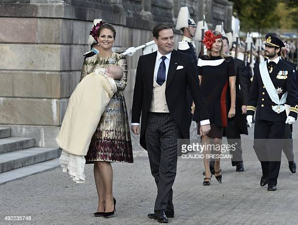 Sweden's Prince Madeleine holds her newly baptised son Prince Nicolas as she leaves the church with her husband Chris O'Neill after the prince's...