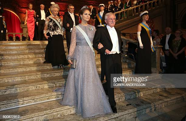 Sweden's Princess Madeleine and Nobel Chemistry Prize 2015 cowinner US Paul Modrich arrive for the 2015 Nobel Banquet at the Stockholm City Hall on...