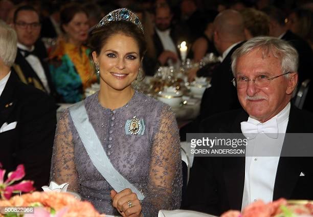 Sweden's Princess Madeleine and Nobel Chemistry Prize 2015 cowinner US Paul Modrich attend the 2015 Nobel Banquet at the Stockholm City Hall on...
