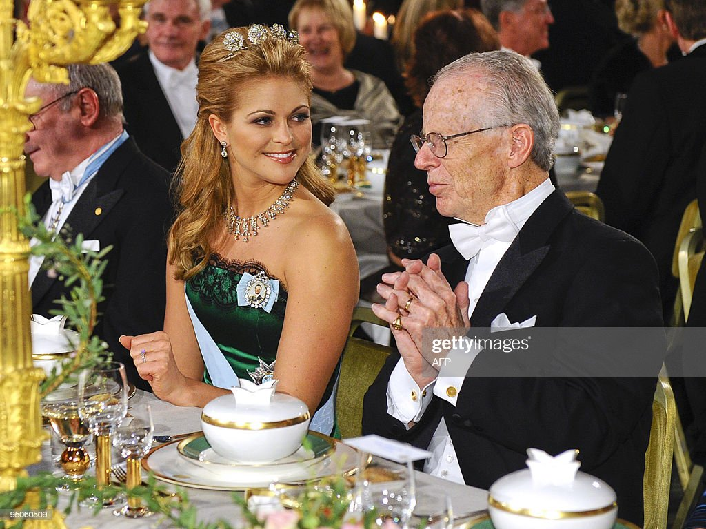 Sweden's Princess Madeleine sits with Nobel Economics laureate Oliver Williamson at the Nobel banquet in the Stockholm Town Hall on December 10 2009...