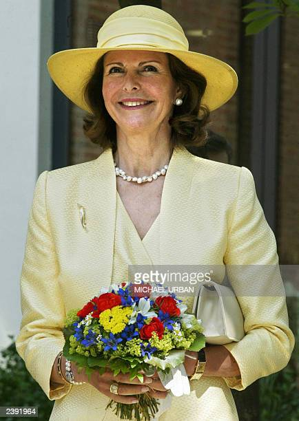 Sweden's Queen Silvia smiles 15 June 2003 during her visit with her husband King Carl Gustav to the Swedish cummunity of Berlin The Swedish royal...