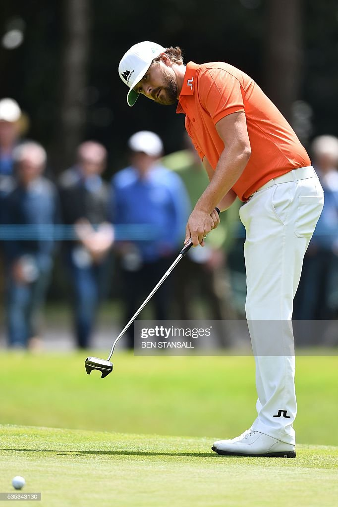 Sweden's Rikard Karlberg putts on the 13th green during the fourth day of the golf PGA Championship at Wentworth Golf Club in Surrey, south west of London, on May 29, 2016. / AFP / BEN