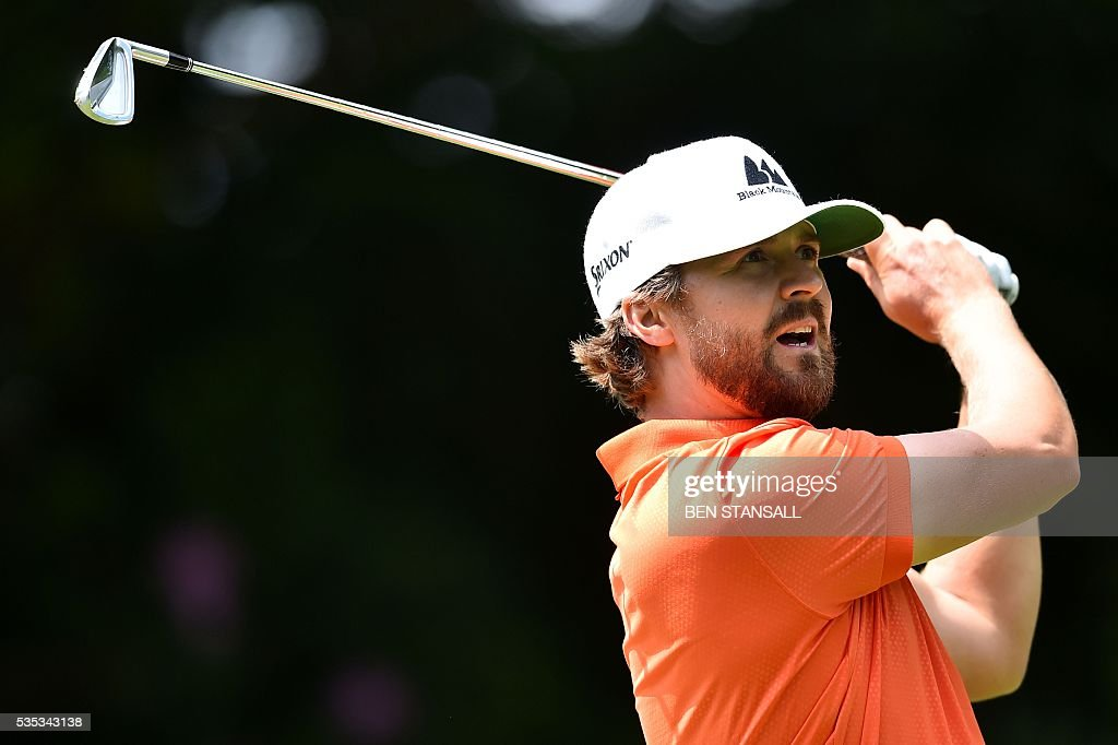 Sweden's Rikard Karlberg reacts after hitting a tee shot on the 14th hole during the fourth day of the golf PGA Championship at Wentworth Golf Club in Surrey, south west of London, on May 29, 2016. / AFP / BEN
