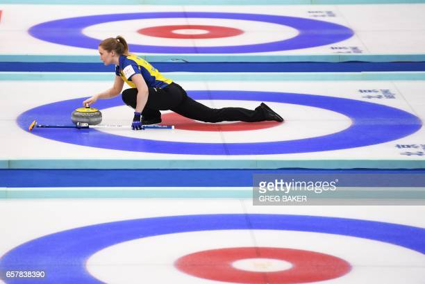 TOPSHOT Sweden's Sara McManus releases the stone during their bronze medal match against Scotland at the Women's Curling World Championships in...