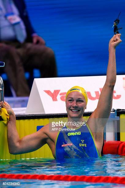 Sweden's Sarah Sjostrom reacts after competing in the women's 50m Butterfly final during the swimming competition at the 2017 FINA World...