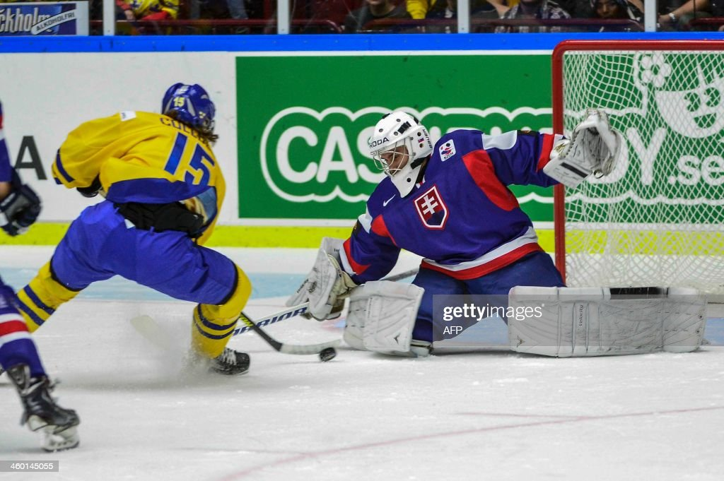 Sweden's Sebastian Collberg alone with Slovakia's goalie Richard Sibol, but Collberg did not score, during the World Junior Hockey Championships quarter final between Sweden and Slovakia at the Malmo Arena in Malmo, Sweden on Januar 2, 2014. AFP PHOTO / LUDVIG THUNMAN /