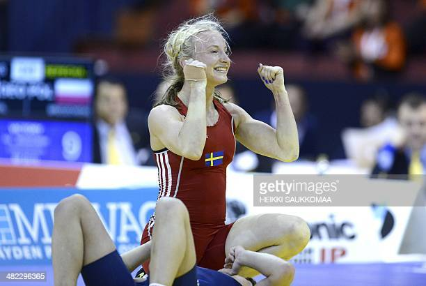 Sweden's Sofia Magdalena Mattsson and Polish Anna Teresa Zwirydowska compete during the match of women's freestyle 55 kg category of the Wrestling...