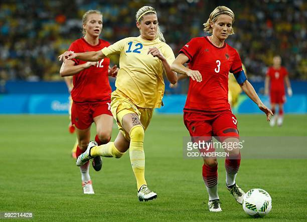 Sweden's striker Olivia Schough and Germany's defender and captain Saskia Bartusiak vie for the ball during the Rio 2016 Olympic Games women's...