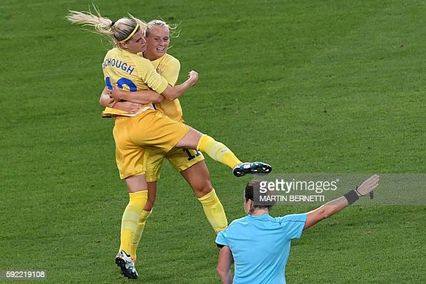 Sweden's striker Stina Blackstenius celebrates with Sweden's striker Olivia Schough after scoring a goal during the Rio 2016 Olympic Games women's...
