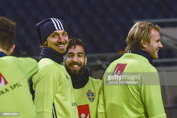 Sweden's striker Zlatan Ibrahimovic Sweden's midfielder Jimmy Durmaz and Sweden's midfielder Ola Toivonen share a laugh during a training session on...