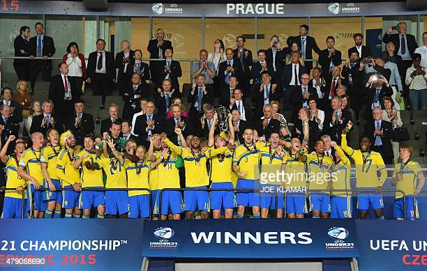 Sweden's team celebrates the victory with the trophy after the UEFA Under 21 European Championship 2015 final football match between Sweden and...