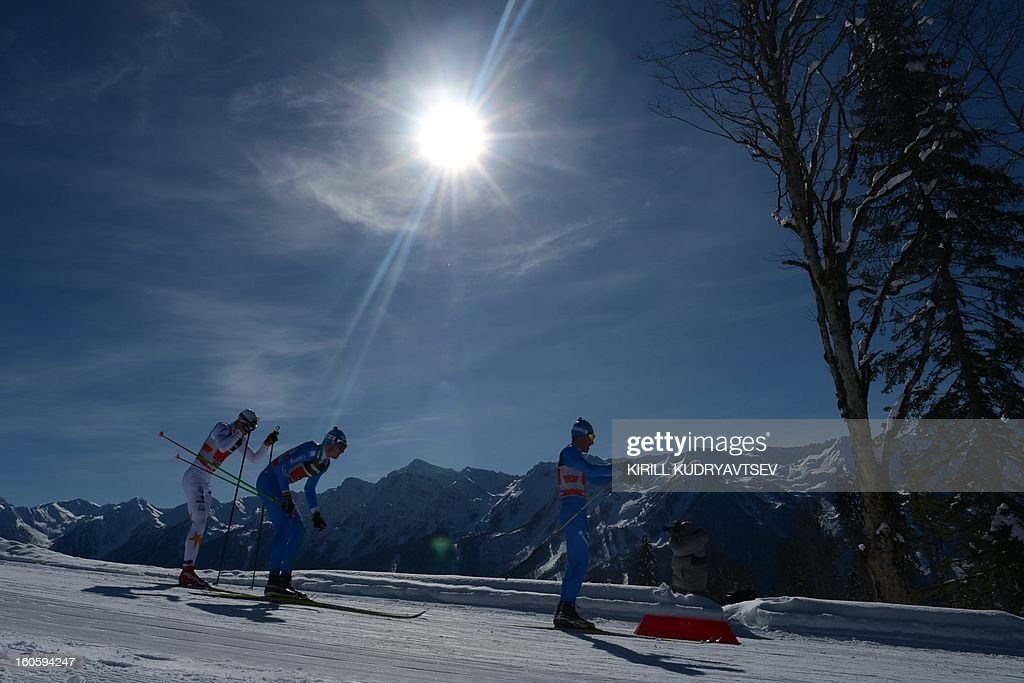 Sweden's Teodor Peterson (L) competes during 6 x 1,8 km Men's Classic Team Sprint of FIS Cross Country skiing World Cup at Laura Cross Country and Biathlon Center in Russian Black Sea resort of Sochi on February 3, 2013. Russia's Maxim Vylegzhanin and Dmitry Japarov took the first place ahead of Sweden's Teodor Peterson and Emil Joensson and Germany's Axel Teichmann and Tobias Angerer. AFP PHOTO/KIRILL KUDRYAVTSEV