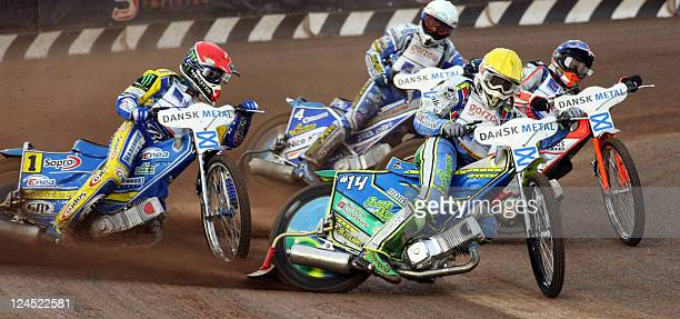 Sweden's Tomasz Gollob and Antonio Lindback compete during the FIM Speedway Grand Prix 2011 at Vojens' Speedway Center on September 10 2011 AFP PHOTO...