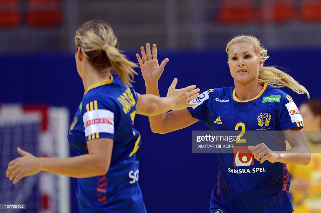 Sweden's Ulika Argen (R) and Sabina Jacobsen (L) celebrate after scoring a goal aganst Macedonia during the Women's EHF Euro 2012 Handball Championship match between Macedonia and Sweden in Nis on December 6, 2012.