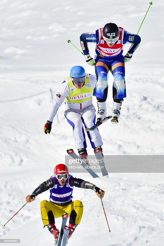 Sweden's Victor Oehling Norberg (R) jumps into the finish area to take first place followed by second placed Russia's Sergey Ridzik (C), third placed Germany's <a gi-track='captionPersonalityLinkClicked' href=/galleries/search?phrase=Daniel+Bohnacker&family=editorial&specificpeople=6848307 ng-click='$event.stopPropagation()'>Daniel Bohnacker</a> (L) during the Men's Snow Ski Cross Final at FIS World Cup in Arosa, on February 7, 2015.