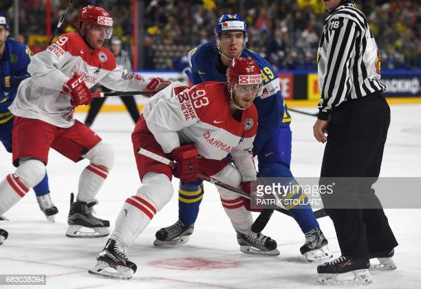 Sweden´s Victor Rask and Denmark´s Peter Regin vie during the IIHF Ice Hockey World Championships first round match between Sweden and Denmark in...