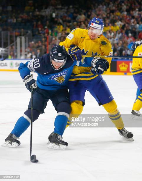 Sweden's Victor Rask and Finland's Julius Honka vie during the IIHF Men's World Championship Ice Hockey semifinal match between Sweden and Finland in...