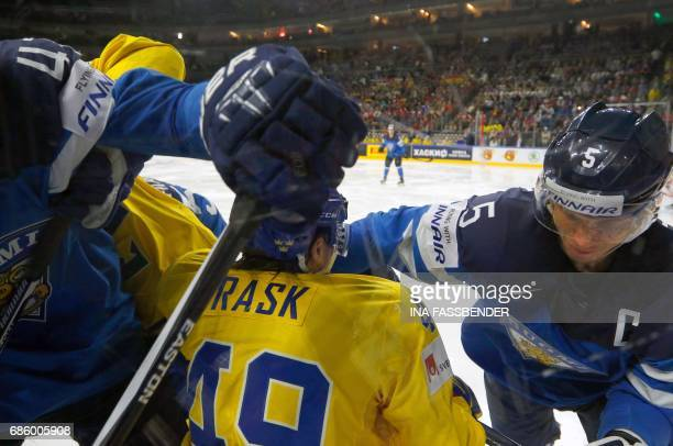 Sweden's Victor Rask and Finland's Lasse Kukkonen vie during the IIHF Men's World Championship Ice Hockey semifinal match between Sweden and Finland...