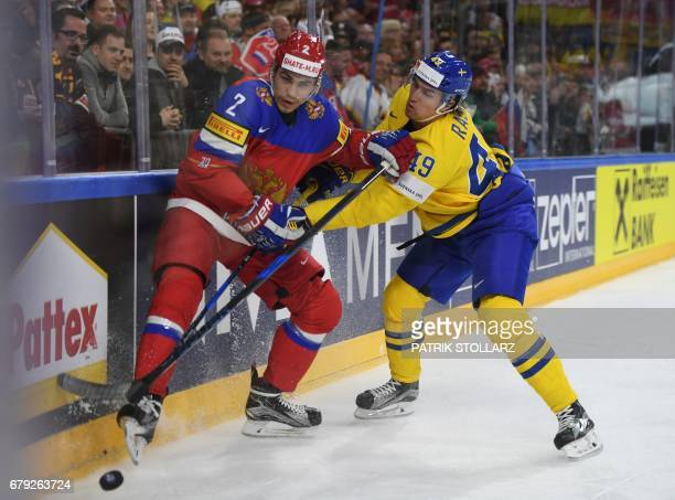 Sweden´s Victor Rask and Russia´s Artyom Zub vie for the puck during IIHF Ice Hockey world championship first round match between Sweden and Russia...