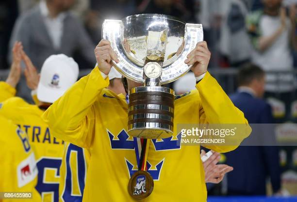 Sweden's Victor Rask celebrates with the trophy after winning on penalties during the IIHF Men's World Championship Ice Hockey final game match...