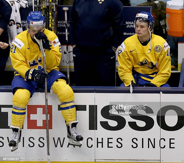 TORONTO JANUARY 5 Sweden's William Nylander and Victor Olofsson take a moment to collect themselves following the loss to Slovakia 2015 IIHF World...