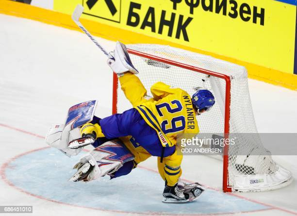 Sweden's William Nylander celebrates with Sweden's goalie Henrik Lundqvist after the penalty shootout of the IIHF Men's World Championship Ice Hockey...