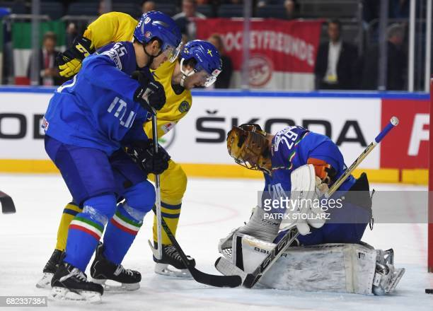 Sweden's William Nylander Italy's Luca Zanatta and Italy's goalie Frederic Cloutier vie during the IIHF Ice Hockey World Championships first round...