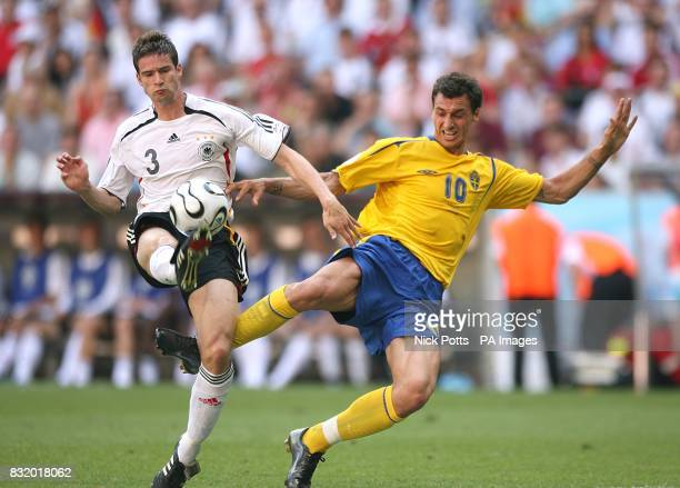 Sweden's Zlatan Ibrahimovic and Germany's Arne Friedrich battle for the ball