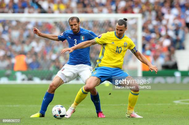 Sweden's Zlatan Ibrahimovic and Italy's Giorgio Chiellini battle for the ball