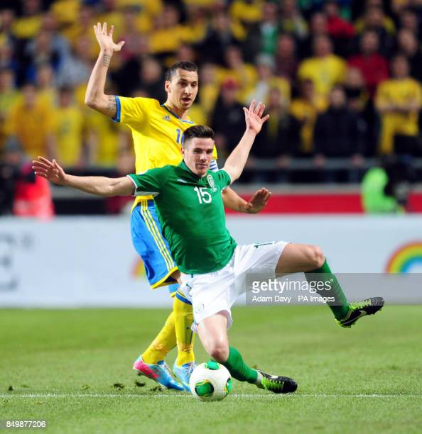 Sweden's Zlatan Ibrahimovic and Republic of Ireland's Claran Clark in action during the FIFA World Cup 2014 Qualifier match at the Friends Arena...