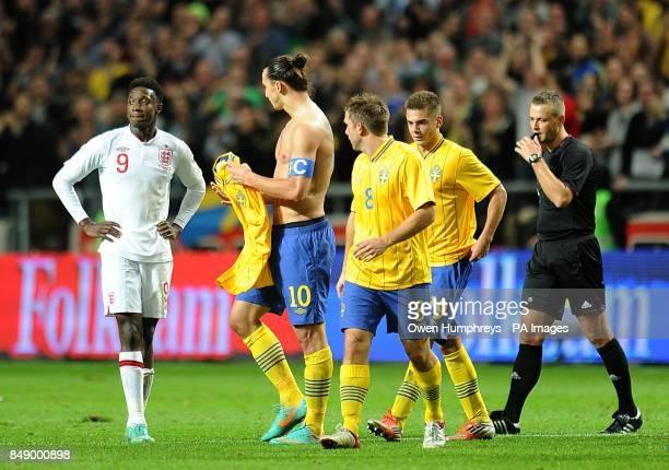 Sweden's Zlatan Ibrahimovic celebrates scoring his and his side's fourth goal of the game as England's Danny Welbeck looks on