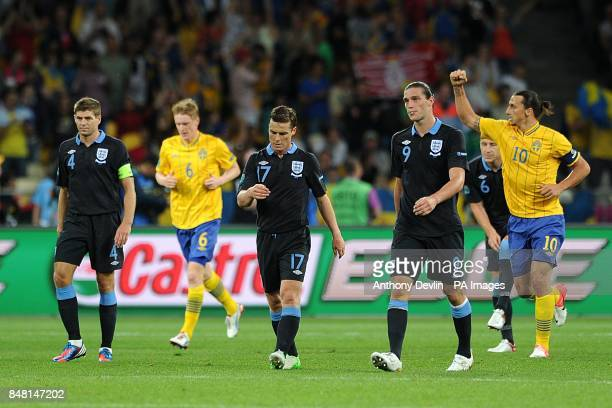 Sweden's Zlatan Ibrahimovic celebrates their second goal as England players Steven Gerrard Scott Parker and Andy Carroll walk back to their half...