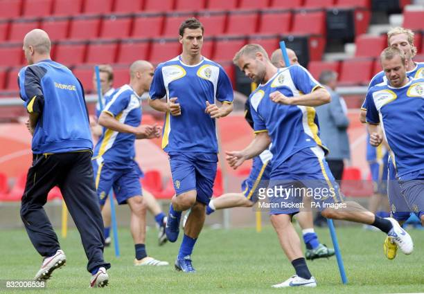 Sweden's Zlatan Ibrahimovic centre0 Olof Mellberg and Marcus Allback during a training session at FIFA World Cup Stadium Cologne Germany