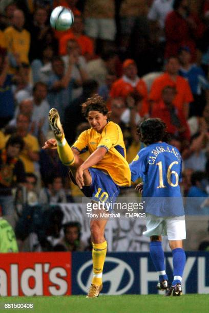 Sweden's Zlatan Ibrahimovic clears the danger from Italy's Mauro Camoranesi