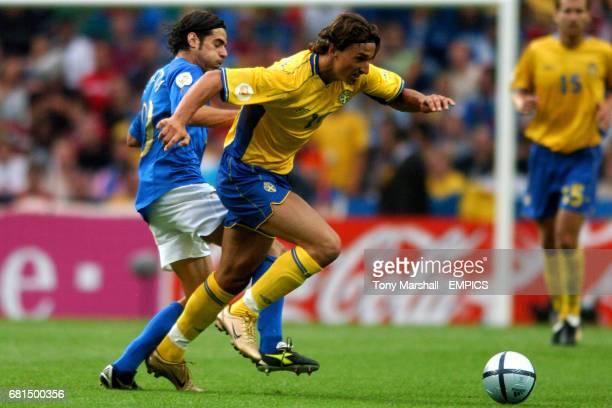 Sweden's Zlatan Ibrahimovic goes past Italy's Simone Perrotta