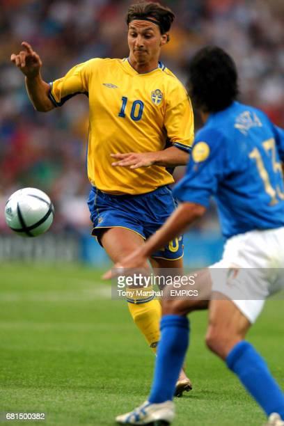 Sweden's Zlatan Ibrahimovic takes on Italy's Alessandro Nesta