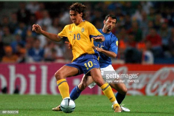 Sweden's Zlatan Ibrahimovic wins the ball ahead of Italy's Giuseppe Favalli